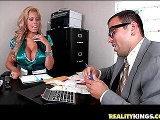 Bridgette B bares her juggs and sucks on Voodoos big cock