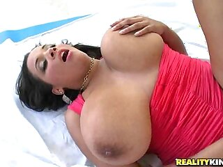 Sexy Latin chick plays with double K boobies