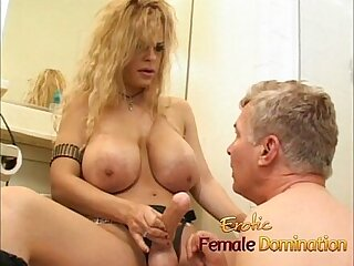 Latex clad busty wench fucks horny stud with strap