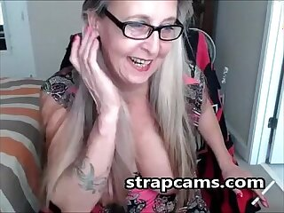 Sexy granny with glasses On Webcam Teasing